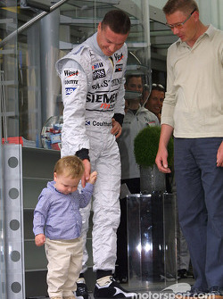 Mika Hakkinen and son Hugo with David Coulthard
