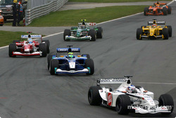 Olivier Panis leading a group of cars