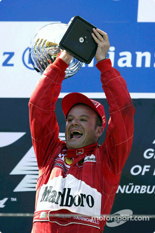 The podium: race winner Rubens Barrichello