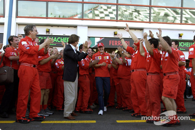 Michael Schumacher and Team Ferrari celebrating