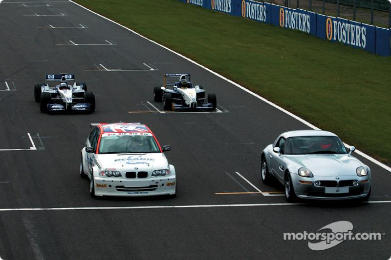 Juan Pablo Montoya in the WilliamsF1 BMW FW24, Bruno Giacomelli in the BMW Z8, Tom Coronel in the BM