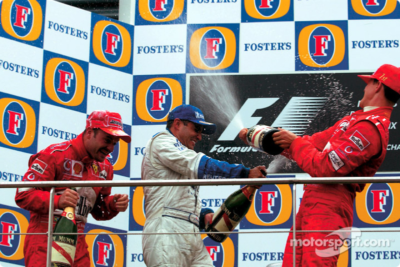 The podium: champagne for Michael Schumacher, Rubens Barrichello and Juan Pablo Montoya