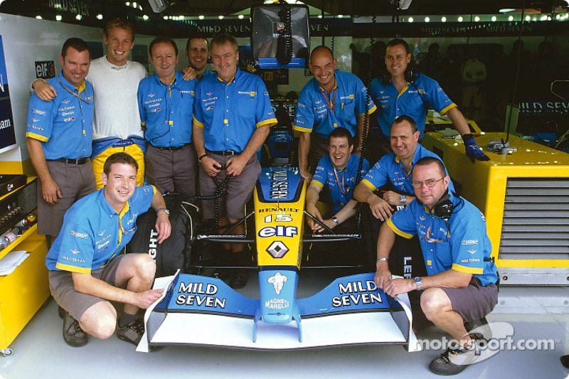 Jenson Button posing with his crew