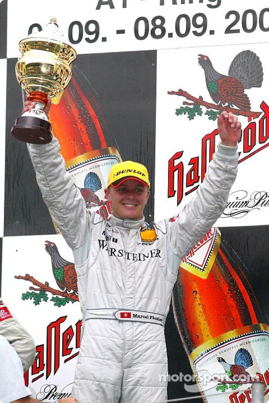 The podium: race winner Marcel Fassler