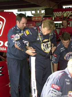 Rusty Wallace strapping into his HANS