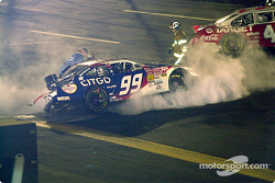 The fire extinguishers go off in Jeff Burton's car