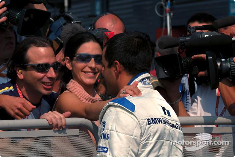 Pole winner Juan Pablo Montoya and girlfriend Connie