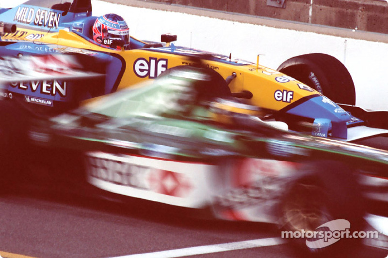 Jenson Button waits during Sunday warm up