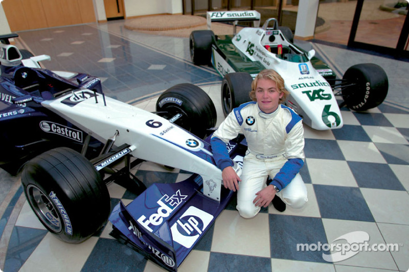 Nico Rosberg with the 2002 Williams FW24 and the Williams FW08 his dad Keke drove the the World Cham