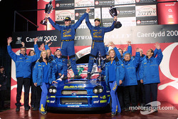 Petter Solberg and co-driver Phil Mills celebrate their win