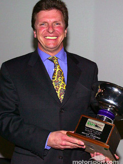 Salute to 2002 champions: Didier Theys receives the 2002 Grand-Am Driver Champion trophy