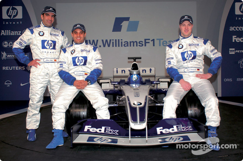 Test driver Marc Gene, Ralf Schumacher, Juan Pablo Montoya, and the new BMW Williams F1 FW25