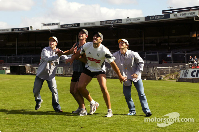 Fernando Alonso and Jarno Trulli play with Australian-rule football stars Alan Didak and Anthony Roc