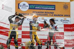 The podium: champagne for race winner Katsuaki Fujiwara with Chris Vermeulen and Alessio Corradi