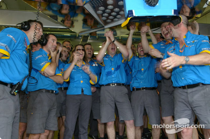 Renault F1 team members celebrate pole position and first row