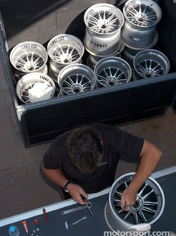 McLaren team member prepares the wheels