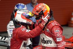 Rubens Barrichello congratulates Michael Schumacher