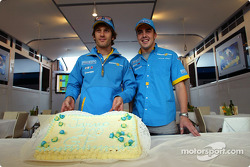 Jarno Trulli celebrates his 100th Grand Prix start with Fernando Alonso