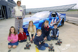 Anthony Swan and kids with the Lego Racers car