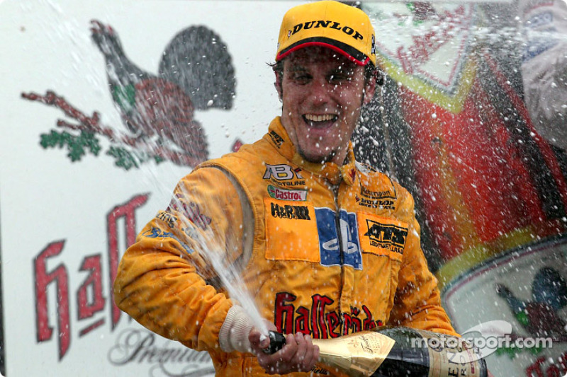 The podium: champagne for Laurent Aiello
