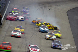Coming out of turn 4 on the first lap, the action starts with Casey Mears…