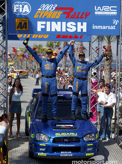 Petter Solberg and codriver Phil Mills celebrate victory