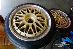 Ferrari wheels sit idly waiting for their ride to the track