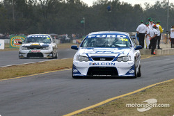 Davis Besnard leaves the pits with team mate Craig Lowndes on pit straight