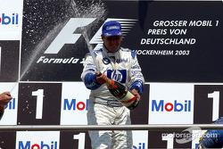The podium: champagne for race winner Juan Pablo Montoya