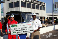 Pole winner Helio Castroneves accepts MBNA pole award from Parrish Henry