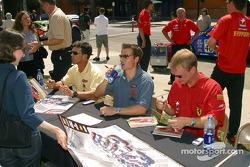 Craig Stanton, Johnny Mowlem and Jan Magnussen sign autographs for fans in San Jose's Cesar Chavez Park