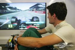 Mark Webber watches Justin Wilson's qualifying run
