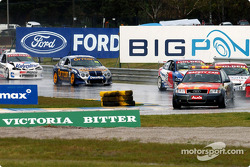The safety car leads the field following the rain and hail storms