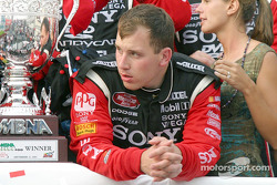 A tired Ryan Newman waits for the next hat