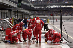 Ferrari team members prepare pit area