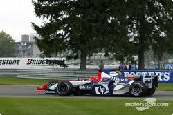 Juan Pablo Montoya passes Michael Schumacher