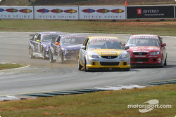 Robert Baxter battles with a group of cars