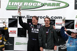 The podium: race winner Johnny Miller
