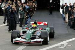Mark Webber exits the marquee and drives onto the track to test the new Jaguar R5