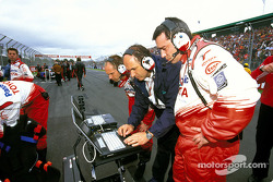 Toyota team members on the starting grid