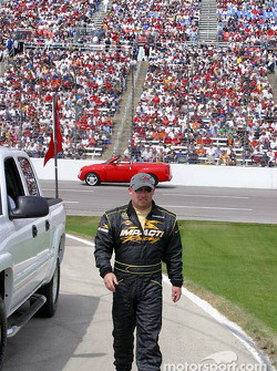 Todd Bodine walks to the starting grid