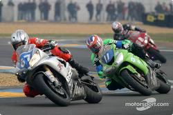 #67 3A Racing Team Yamaha R1: Grég Boulanger, Magali Langlois, Nicolas Ezannic, and #11 Kawasaki Fuchs Kawasaki ZX10 R: Pere Riba, Julien Da Costa, Frédéric Moreira