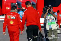 Jean Todt and Michael Schumacher arrive at the track