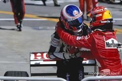Race winner Michael Schumacher and Jenson Button congratulate each other