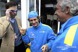 Renault's Louis Schweitzer tries Jarno Trulli's sunglasses while Flavio Briatore has a laugh