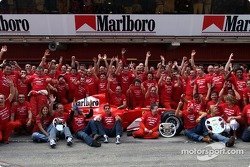 Michael Schumacher, Rubens Barrichello and team Ferrari celebrate victory