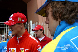 Michael Schumacher and Fernando Alonso wait for drivers parade