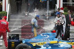 Podium: champagne for Jarno Trulli, Jenson Button and Rubens Barrichello