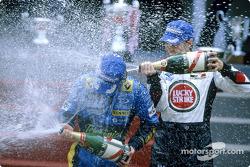 Podium: champagne for Jarno Trulli and Jenson Button