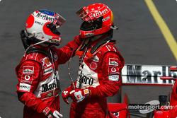 Race winner Michael Schumacher celebrates with Rubens Barrichello